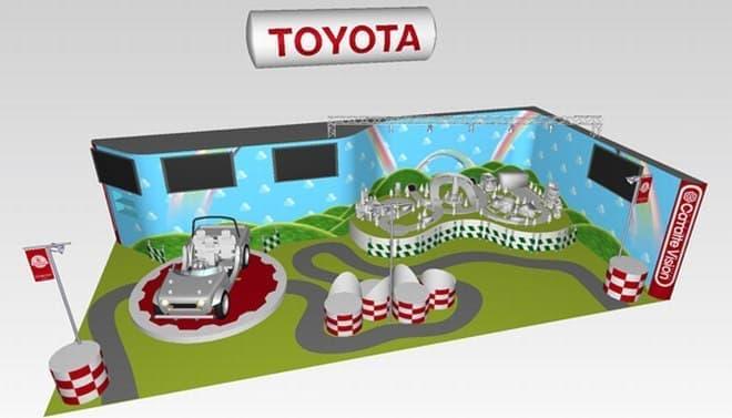「Camatte Vision(カマッテ ビジョン)」ブースイメージ画像  「走行コースの模型」は画像右奥
