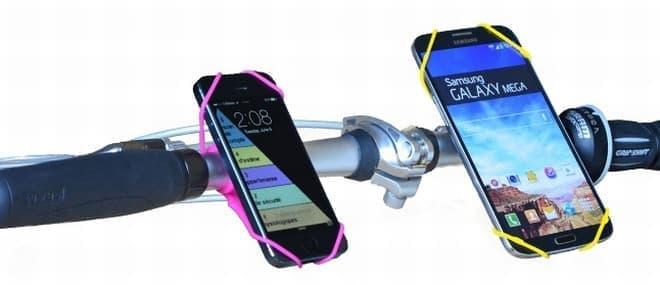 あらゆるサイズのスマートフォンをマウント可能  画像左は5インチサイズのiPhone 5、右は7インチサイズのGalaxy Megaを装着した例